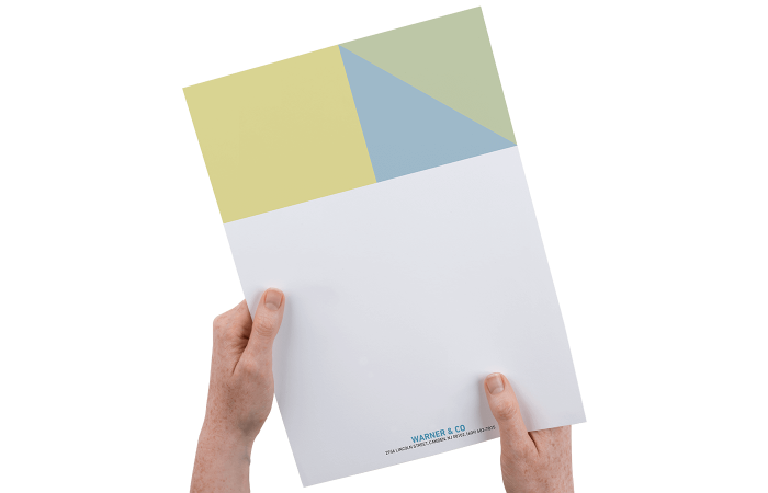 Hands holding a yellow, blue & khaki letterhead on high-quality sheet of paper with branded footer