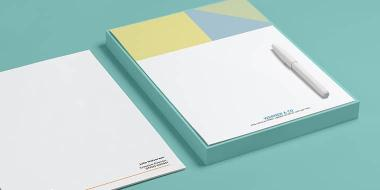 Pile of custom corporate letterheads with minimalist designs