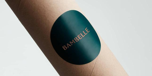 Big glossy round Bambelle label on a cardboard postal tube