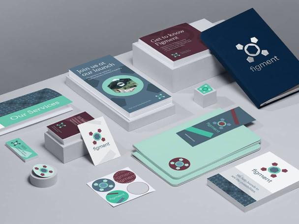 Collection of exclusive custom notebooks, brochures, flyers, stickers, business cards and mini cards created with MOO Business Printing Services