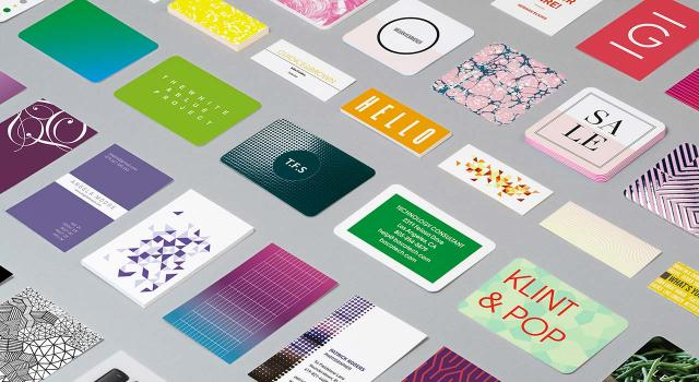 Mosaic of Business Cards in various designs on gray background