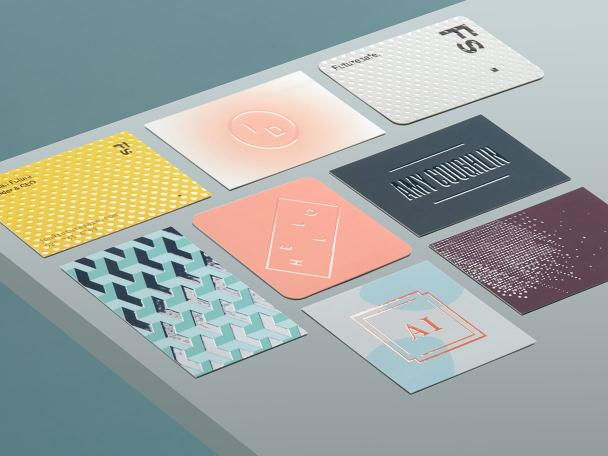 8 Raised Spot UV Business Cards in various sizes, shapes and designs on grey background