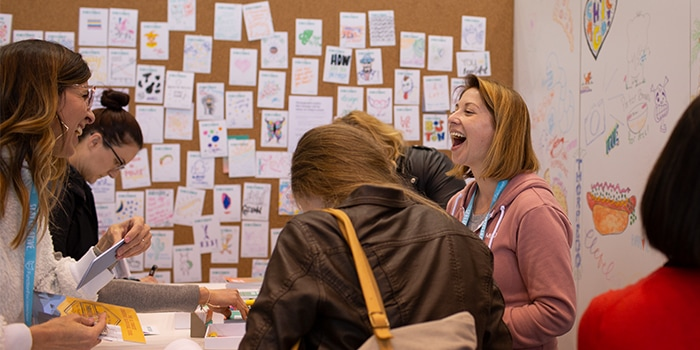 People laughing at exhibition stand