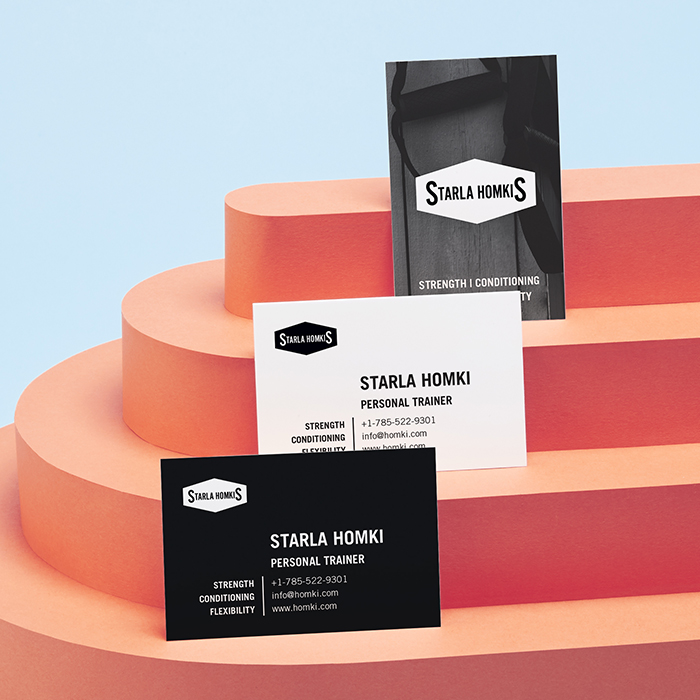 3 Business cards on orange stairs