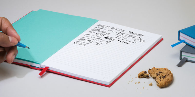 MOO red hardcover work notebook laid open with a person doodling and making notes inside, showing example of notebook organization