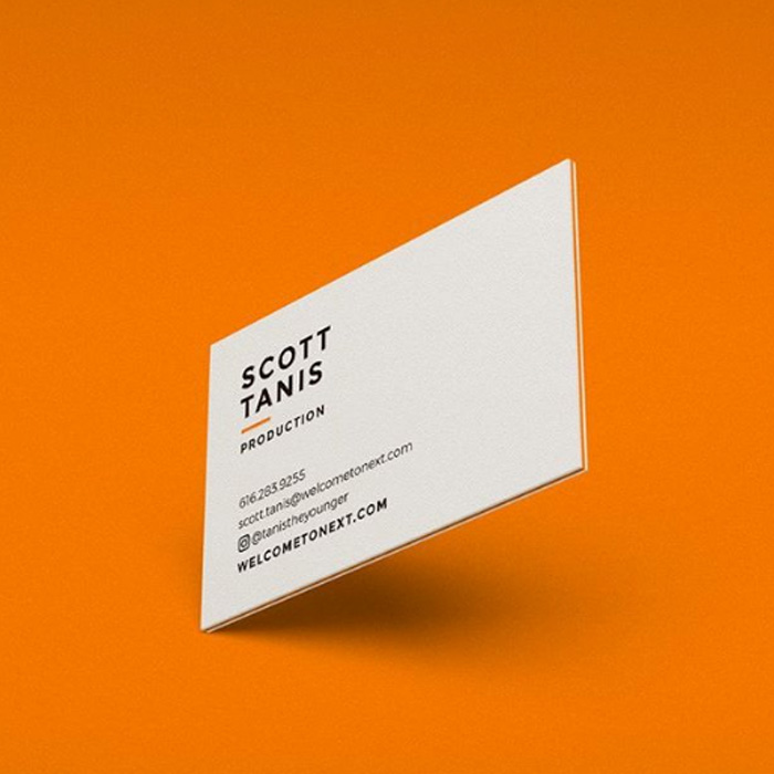 Minimalist business card design against an organe background