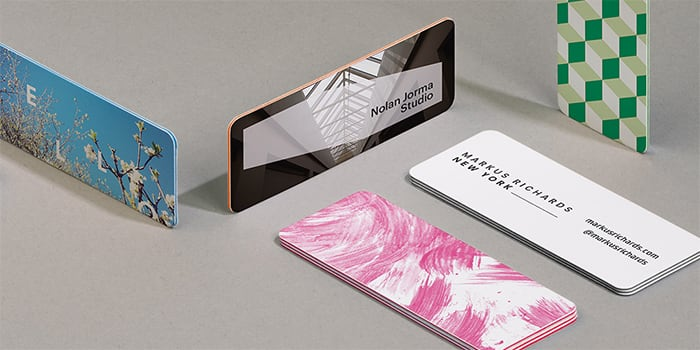A selection of MOO mini business cards in both gloss and matte finishes