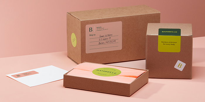 Boxes with address labels and round logo stickers