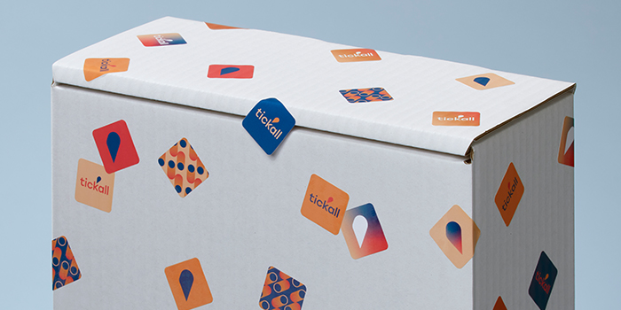 Small square stickers in various designs on a box