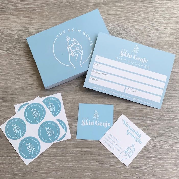 The Skin Genie marketing materials including gift vouchers, stickers and square business cards designed by Beths Branding Co