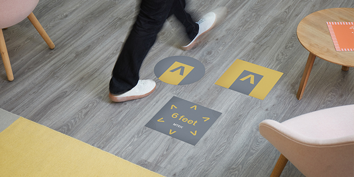 Floor decals for easy social distancing in the office