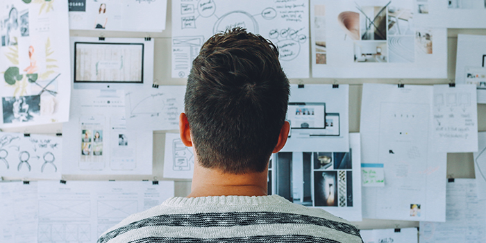 Person looking at an ideas wall