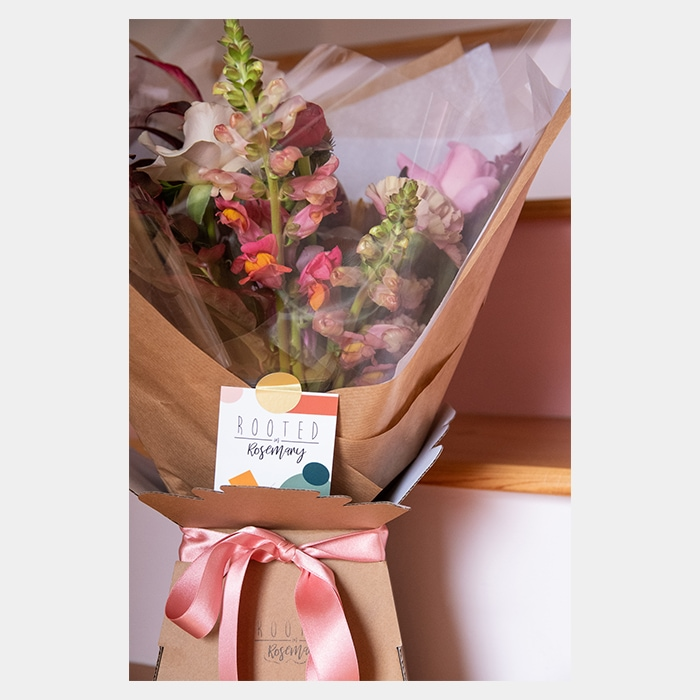Flower bouquet with branded card by Rooted in Rosemary floral design studio in Oxford