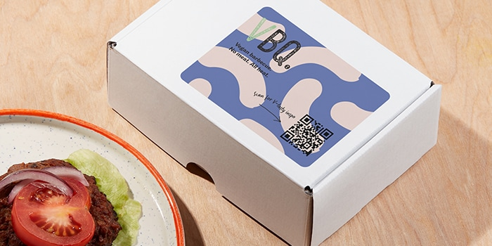 QR code sticker for a vegan barbecue brand on a package