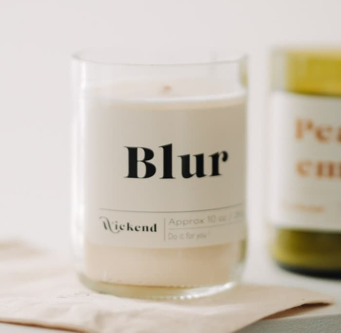 2 Wickend candles with rectangular product labels made with MOO