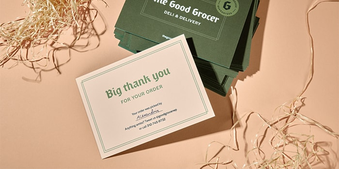 Grocery shop thank you postcard with a green back and a beige front