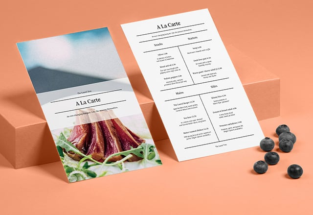 2 minimalist menu designs on high-quality paper, 1 seen from the front and 1 from the back, both on a coral background