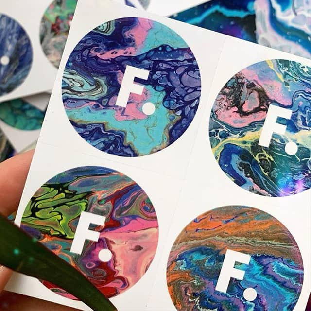 Flossie Art designs on rounded stickers printed by MOO