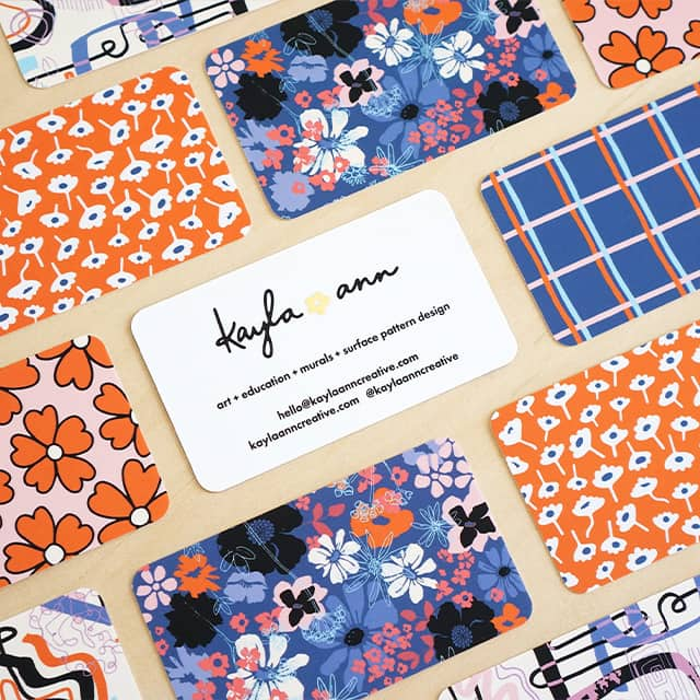 Mosaic of business cards with various floral patterns in blue, pink and coral shades by Kayla Ann Creative