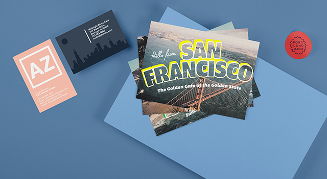 US business cards, postcards and stickers on a blue background