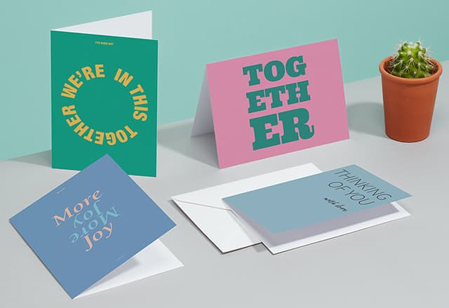 5 horizontal greeting cards with various designs on a green background