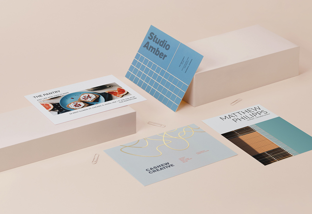 4 medium postcards with full-colour designs and special finishes on a cream-coloured background with paperclips