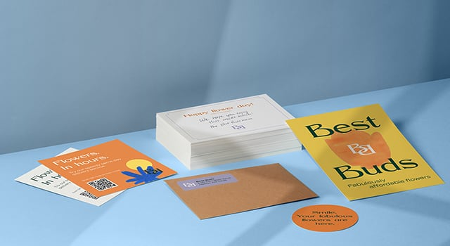 Square cards with QR code, envelope with label, big round sticker, postcards with handwritten notes and flyer for a flower brand