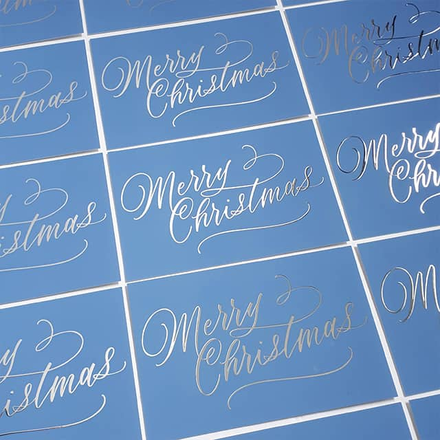Blue Merry Christmas cards with silver foil by EP Lettering printed by MOO