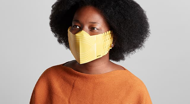 Woman wearing a yellow personalized face mask in recyclable paper