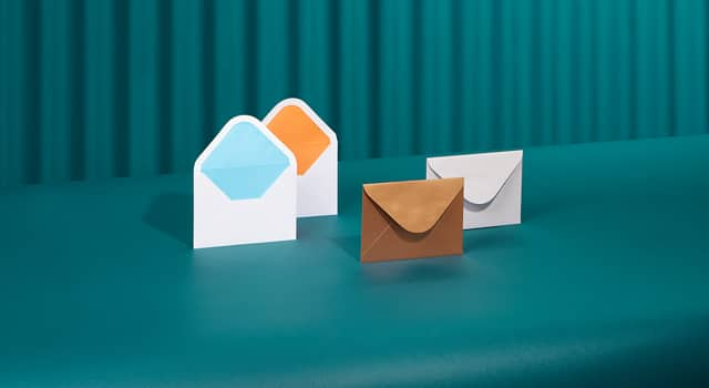 4 open Envelopes with blue and orange pops of color on the inside and 2 closed Envelopes including a Golden Envelope